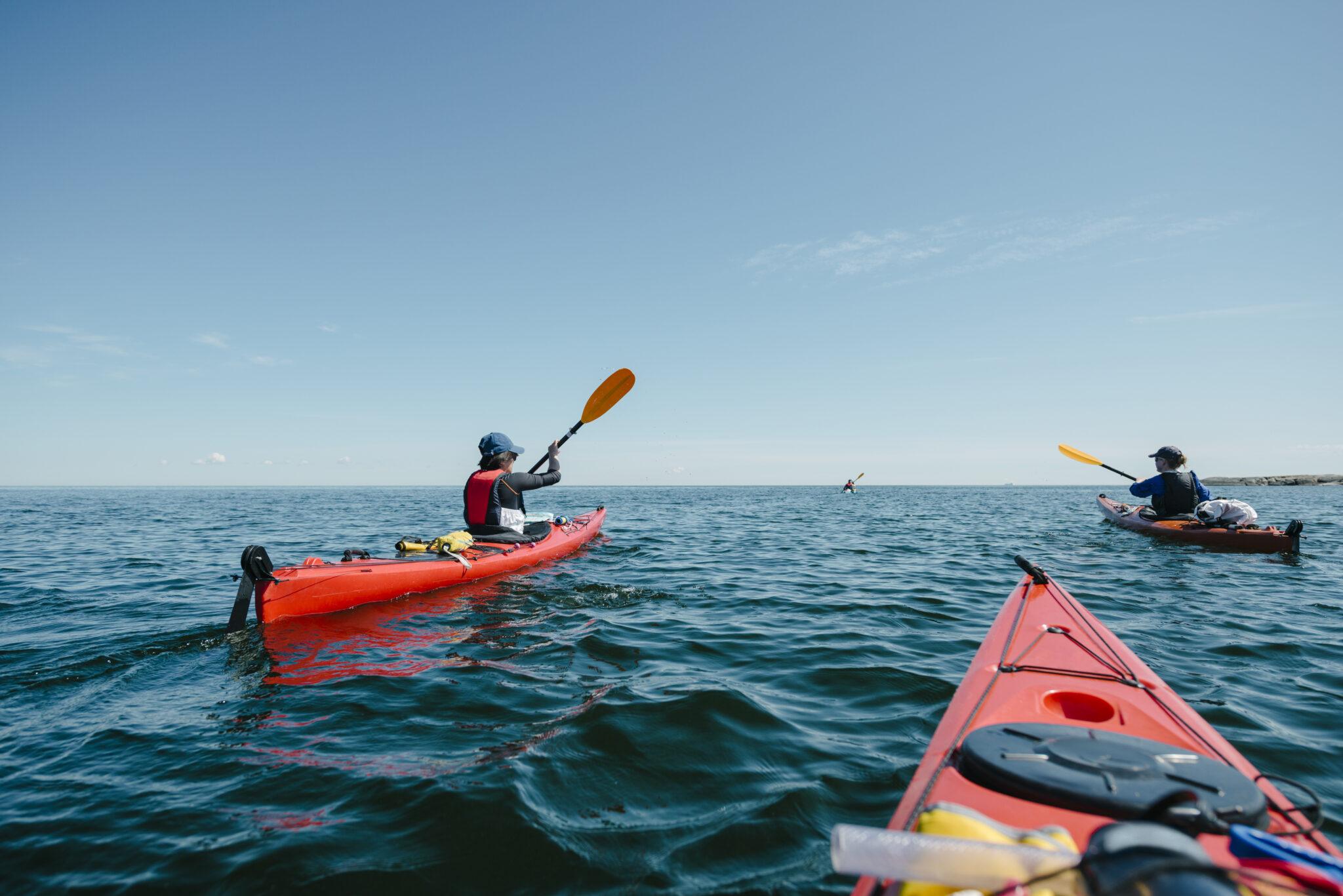 Women kayaking in sea